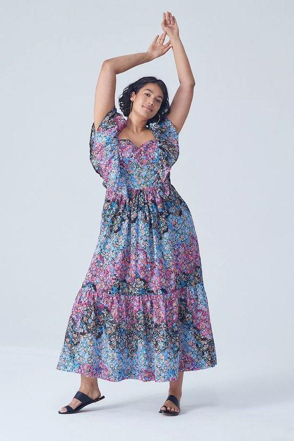 A model wearing a plus-size boho dress.