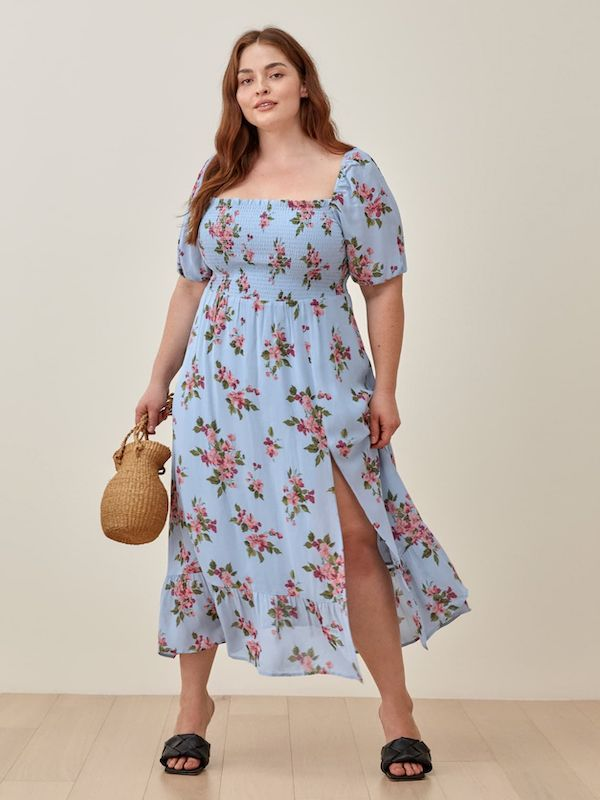 A model wearing a plus-size cottagecore dress.