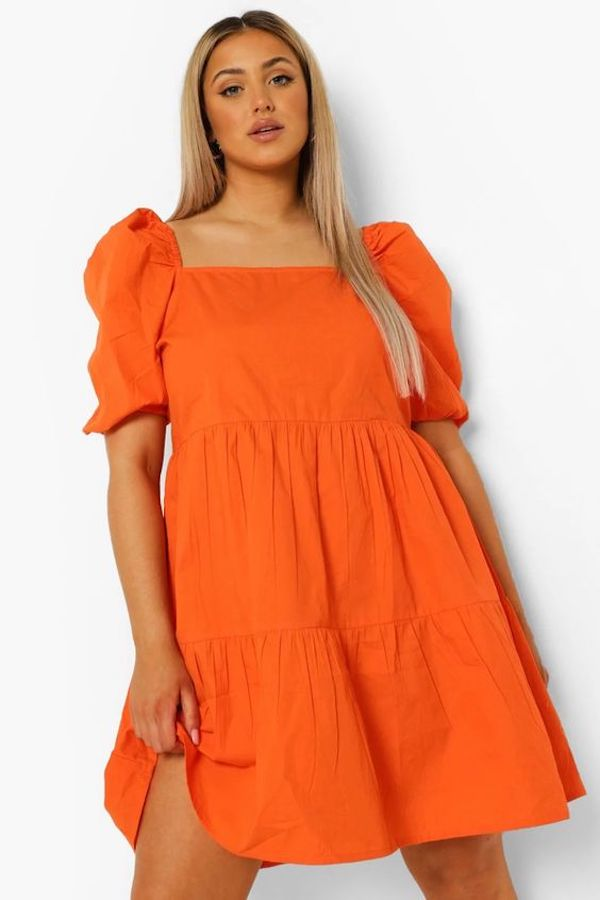 A model wearing a plus-size Easter dress.