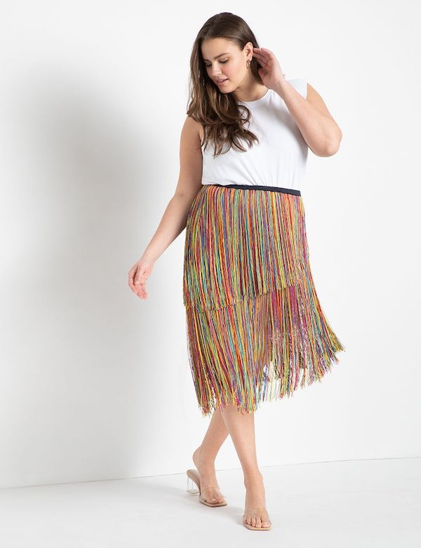 A model wearing a plus-size fringe skirt.