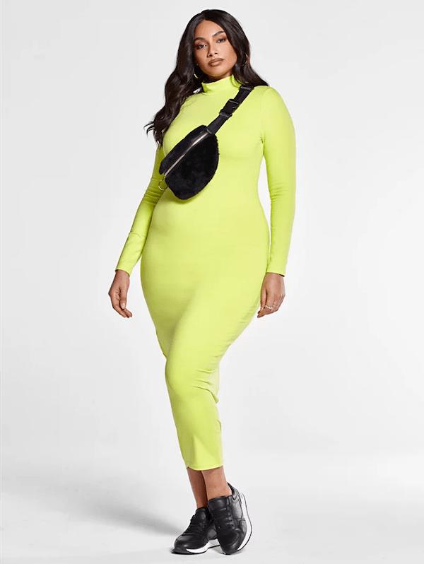 A model wearing a plus-size neon dress.
