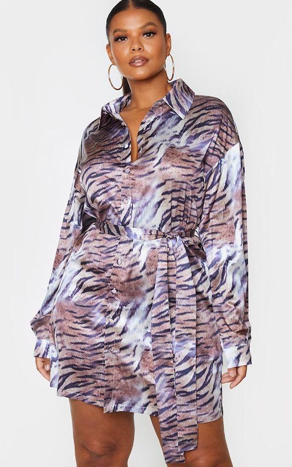 A model wearing a plus-size shirt dress.
