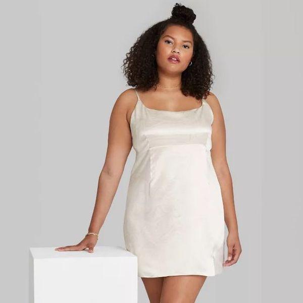 A model wearing a plus-size slip dress.