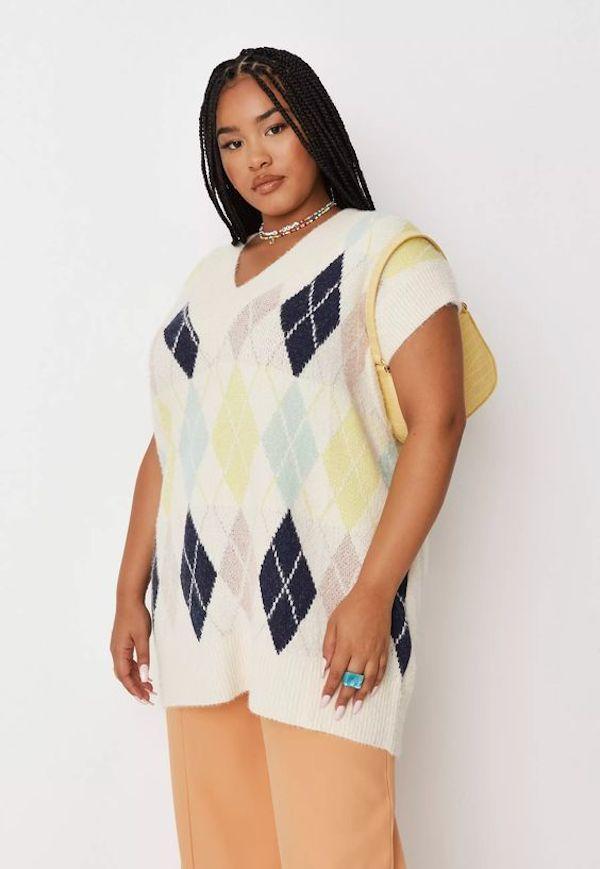 A model wearing a plus-size sweater vest