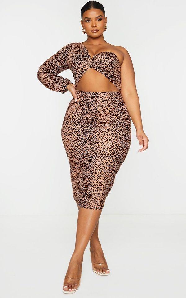A model wearing a plus-size cutout dress.