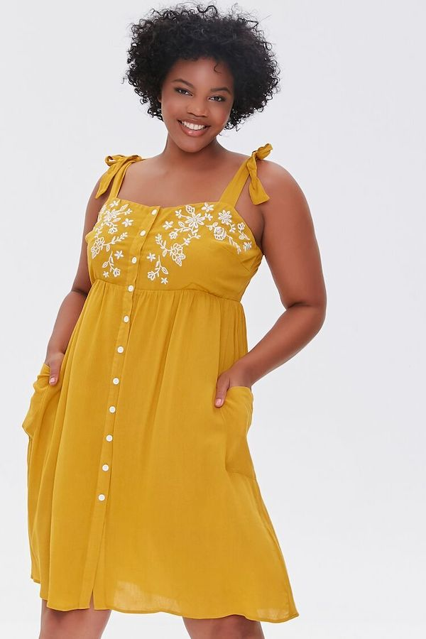 A model wearing a plus-size embroidered dress.