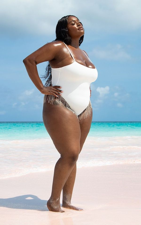A model wearing a plus-size Fourth of July swimsuit.