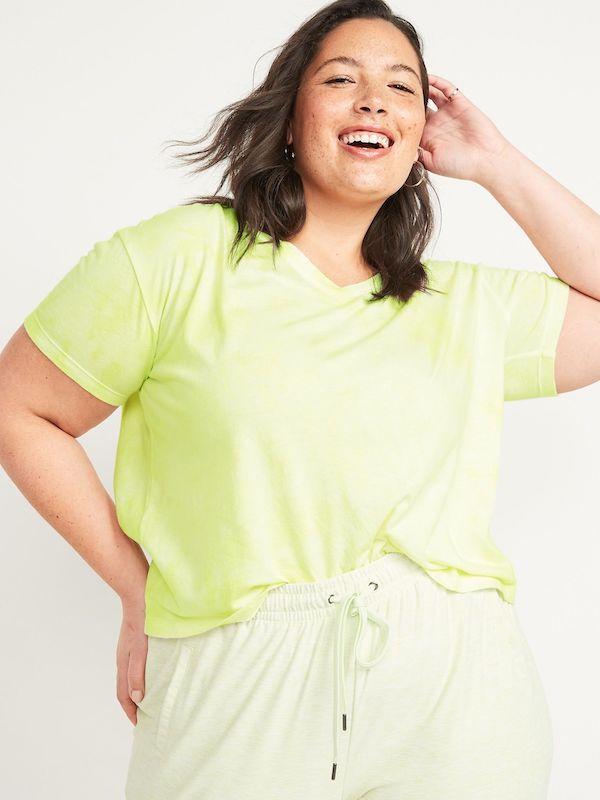 A model wearing a plus-size neon top.