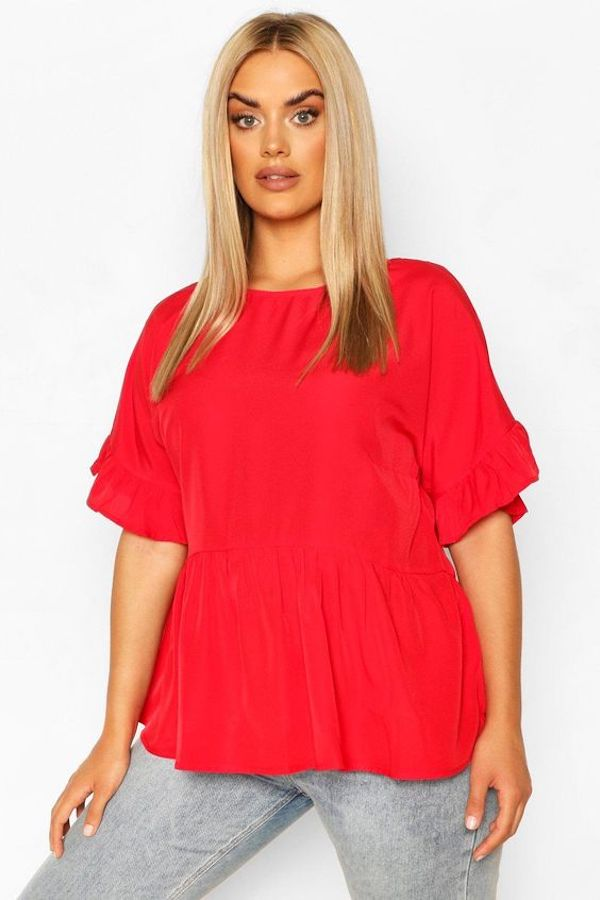 A model wearing a plus-size smock top.