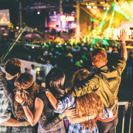 Friends having good time at summer music festival