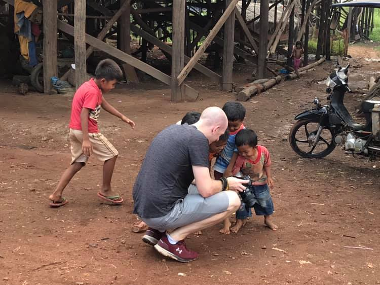 Showing the local kids the photos we had taken... so much enjoyment from something we take for granted... no selfies here!