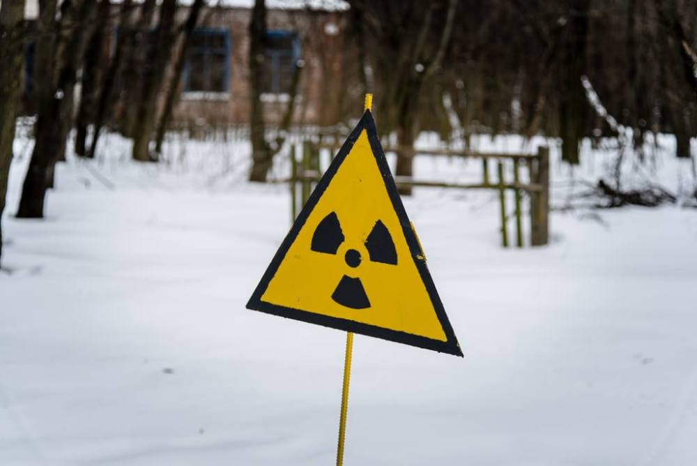 Image of a yellow triangle denoting radiation danger which I have called the flag of Chernobyl because of how common it is in the area.