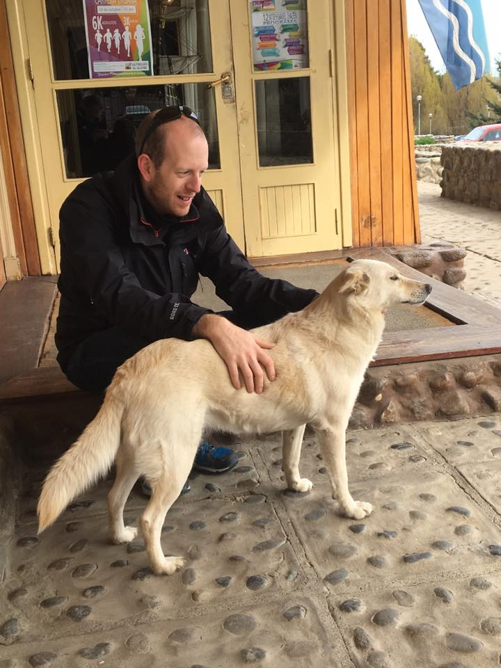 Photo of Doug having made friends with a local dog (this happens on every holiday!)