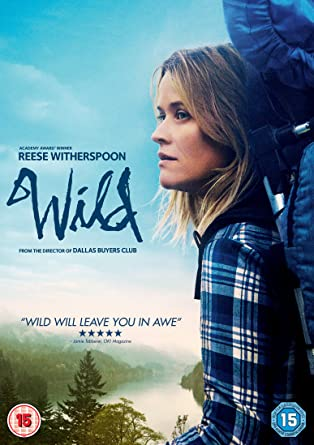 Photo of Reese Witherspoon standing with a heavy backpack with the backdrop of a river and trees. The cover to the movie Wild.