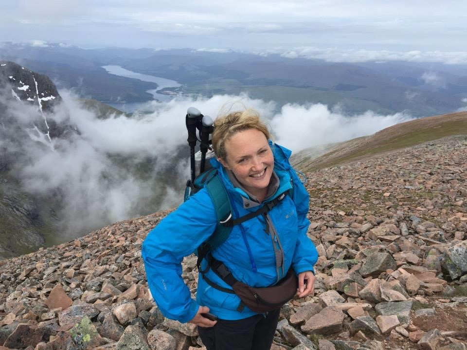 A photo of me smiling on the side of a mountain with a massive drop behind me. This was as I made my way up to Carn Mor Dearg, which would eventually get me to Ben Nevis.
