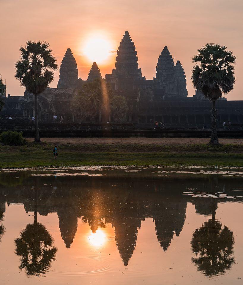 Photo of the reflection of Angkor Wat at sunrise