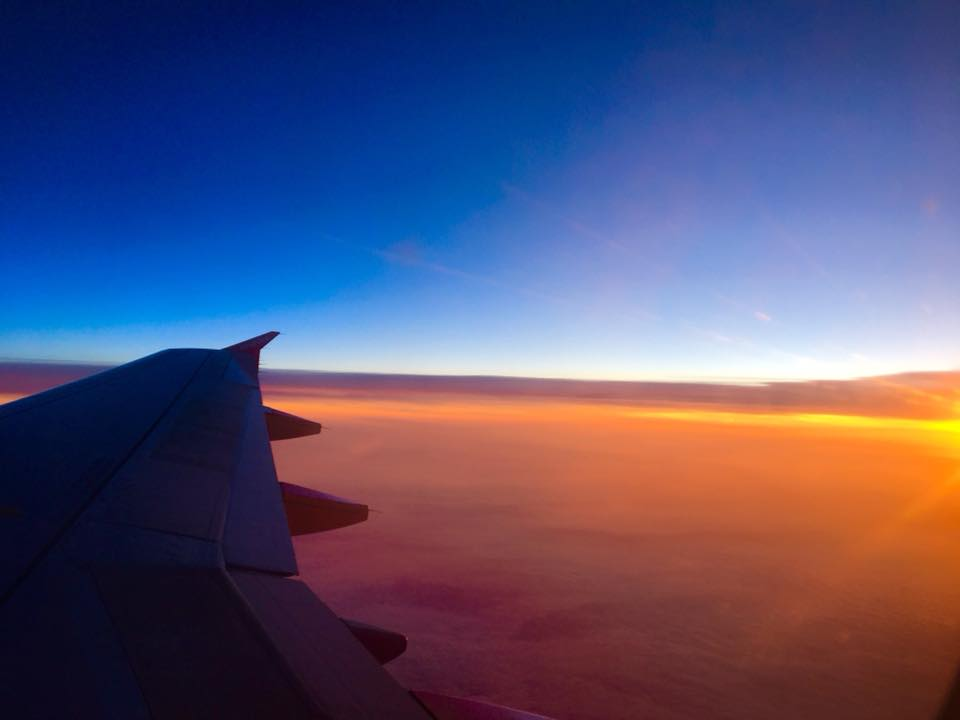Sunset from an airplane window, let the travelling commence!