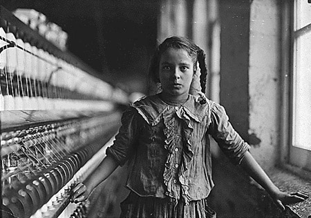 Lewis Hine photo of a child laborer in a factory