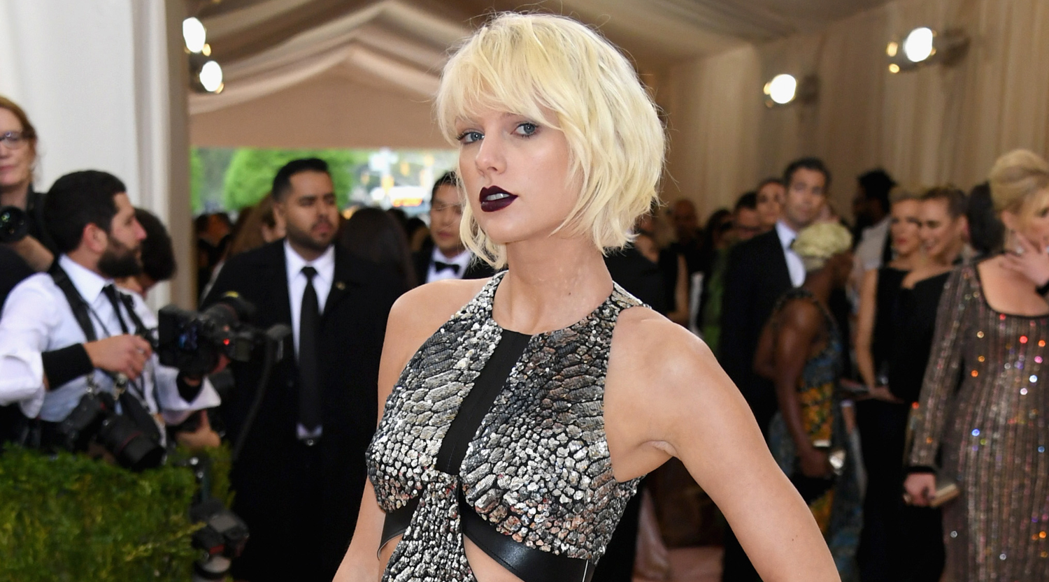 Taylor Swift rocks a metallic silver dress and strappy boots while walking the red carpet at the 2016 Met Gala held at the Metropolitan Museum of Art on Monday (May 2) in New York City. The 26-year-old singer is one of the co-chairs at the event this evening alongside Idris Elba, Vogue editor Anna Wintour, and Apple exec Jonathan Ive. This year's Costume Institute Gala Benefit celebrates the opening of the Manus x Machina: Fashion in an Age of Technology exhibition. FYI: Taylor is wearing a Louis Vuitton dress, boots, and clutch, Mattia Cielo earrings, an Eva Fehren ear cuff and rings, and a Borgioni white diamond ring.