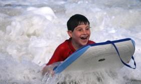 kids boogie boarding