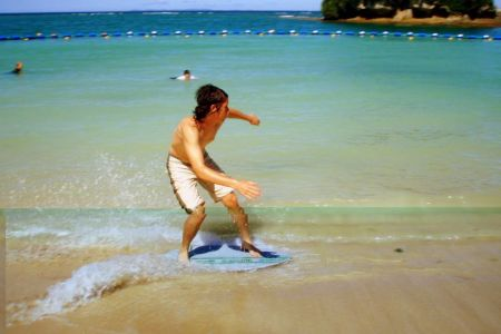 what is skimboarding and how to do it