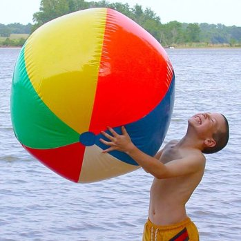 kid playing with beach ball