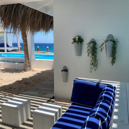 Covered lounge area at your private holiday home Curacao
