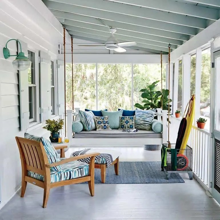 Beach House Outdoor Living Space Ideas - Cozy covered patio with swing bench