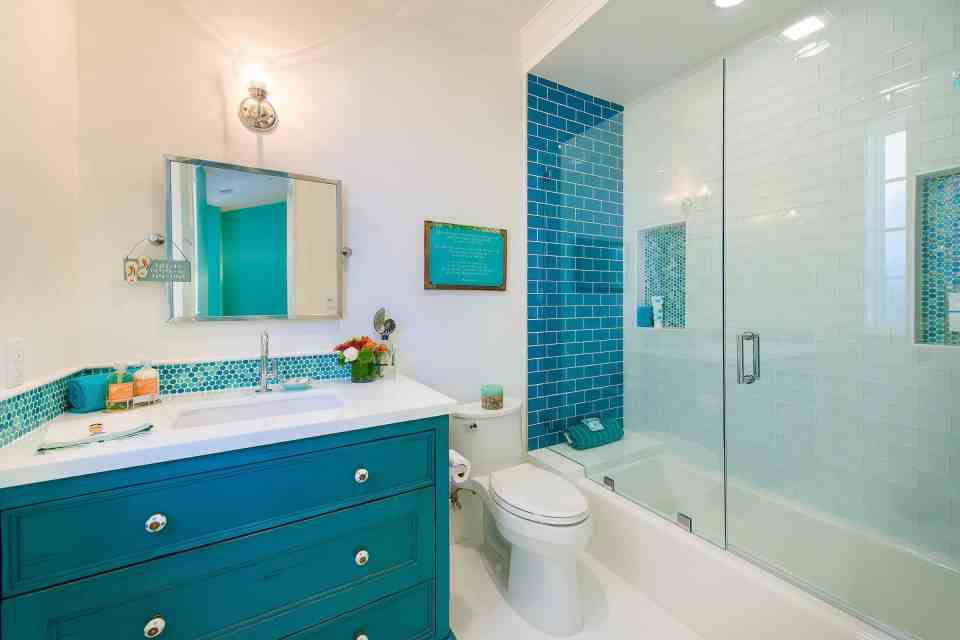 Blue Coastal Dream | Beach House Decor Ideas | Dark teal bathroom vanity and tile