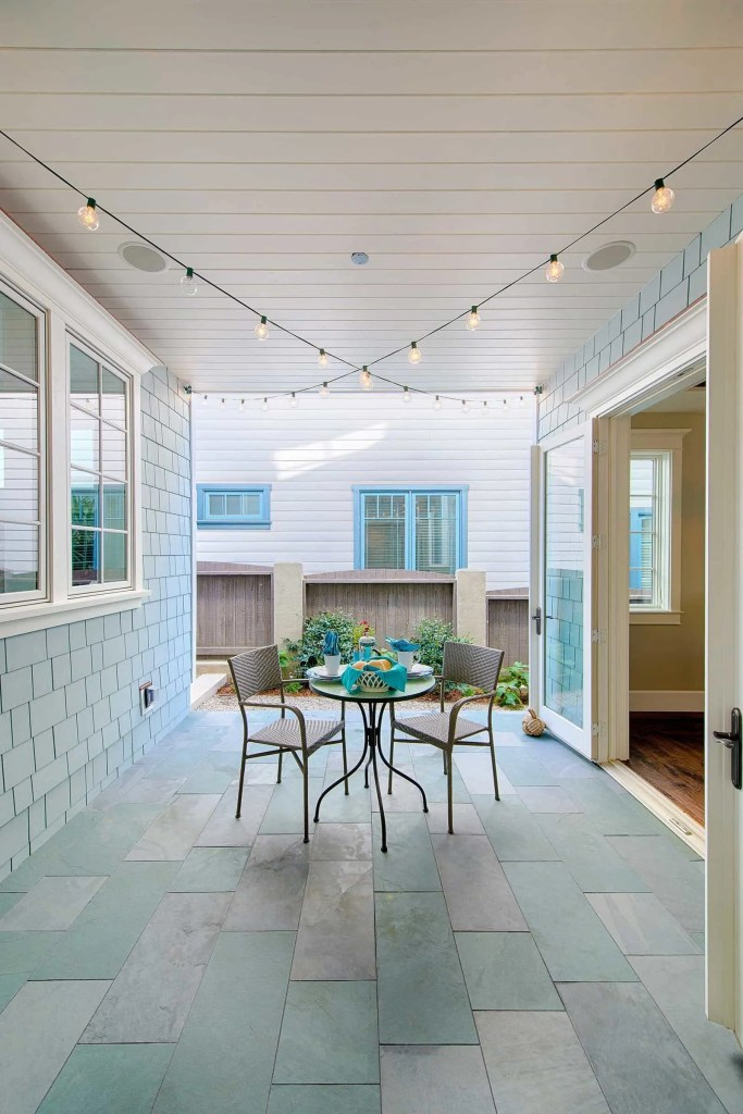 Blue Coastal Dream | Beach House Decor Ideas | Covered patio area with blue and gray floor tiles