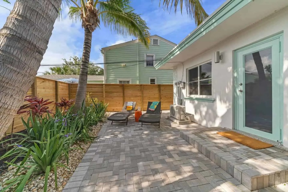 Orange Blossom Villa - Lake Worth Beach Airbnb Vacation Rental - Patio oasis with lounge chairs
