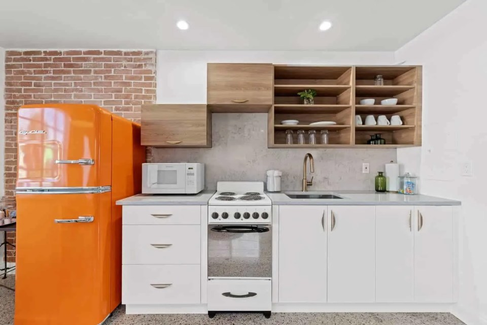 Orange Blossom Villa - Lake Worth Beach Airbnb Vacation Rental - Kitchen with orange retro refrigerator