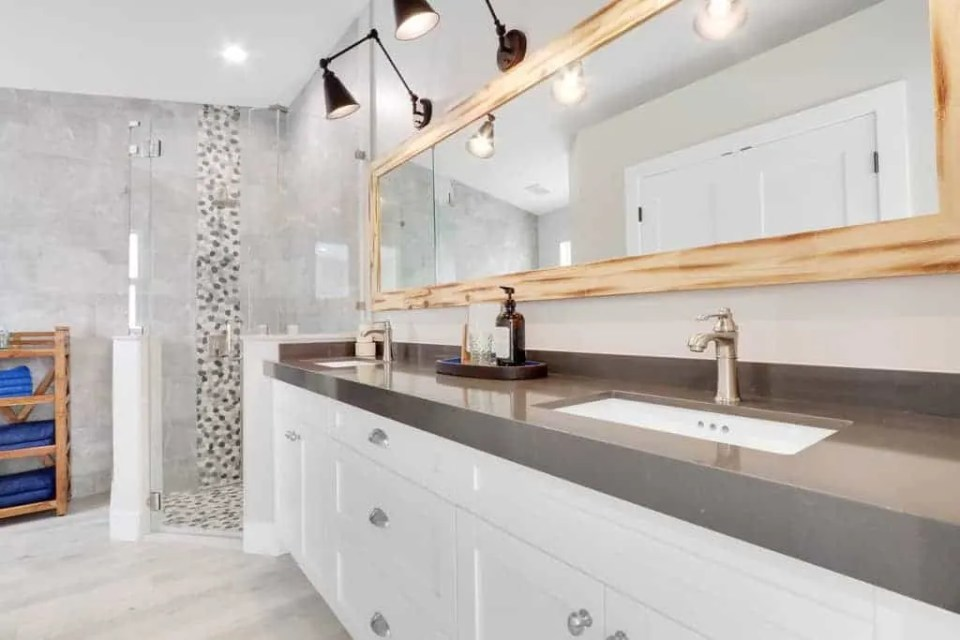 The Bent Palm Jupiter FL AirBnb Master Bathroom with driftwood mirror