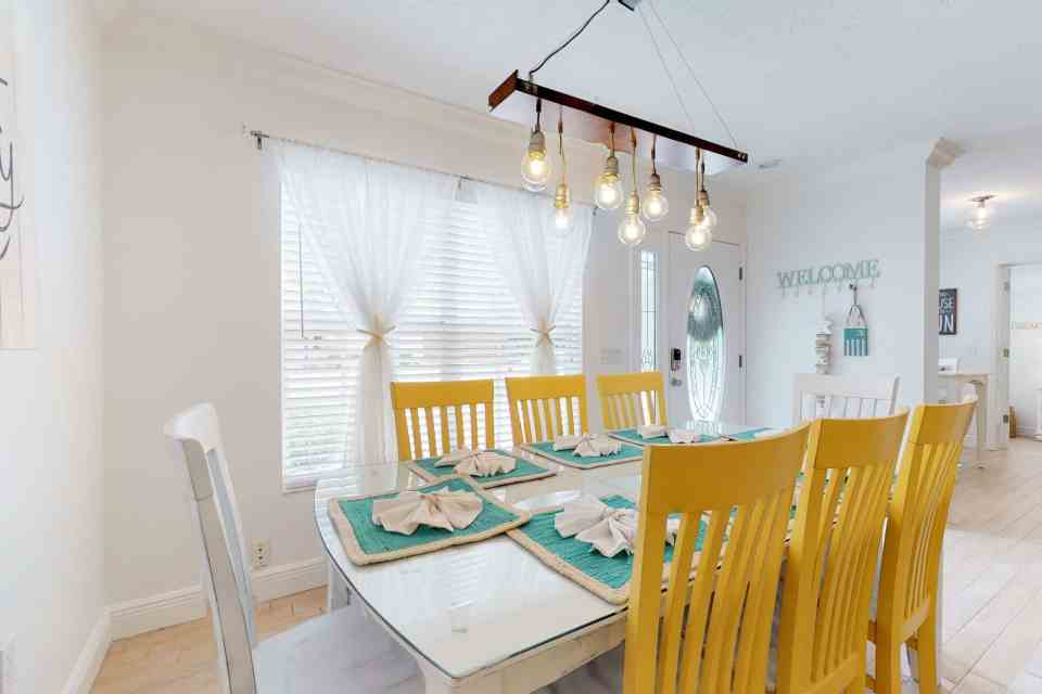 Tranquil Coastal Teal and Yellow Beach House Tour - Dining Room With Teal and Yellow