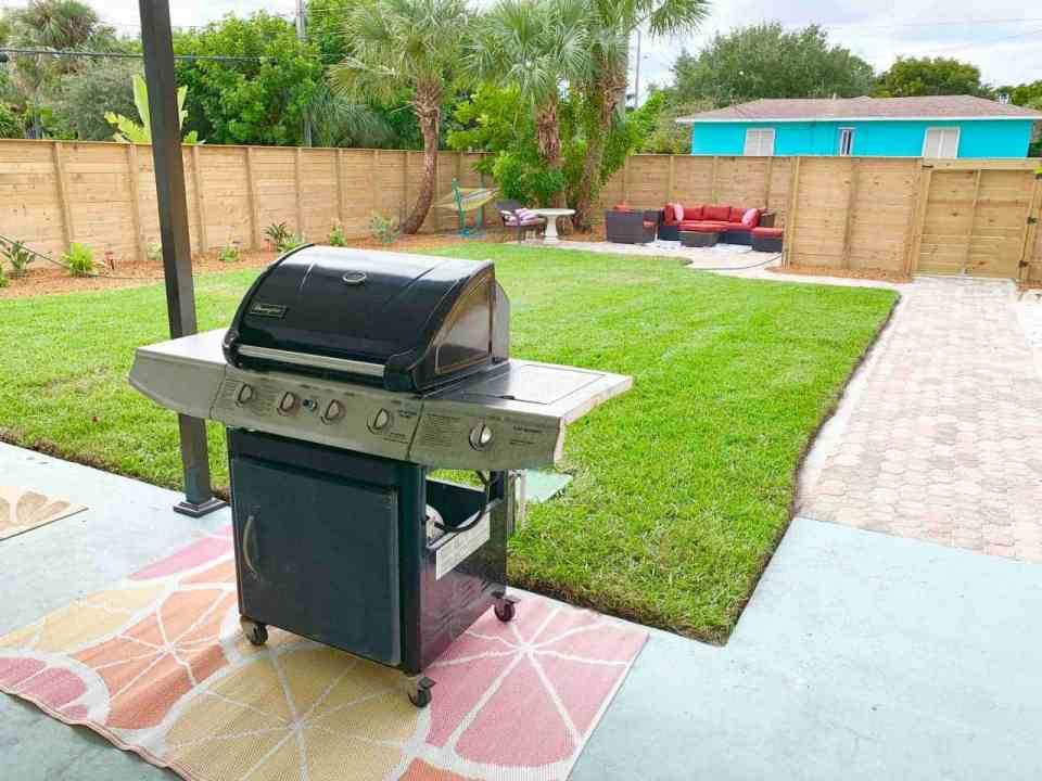 Backyard makeover - grill with grass area and couches
