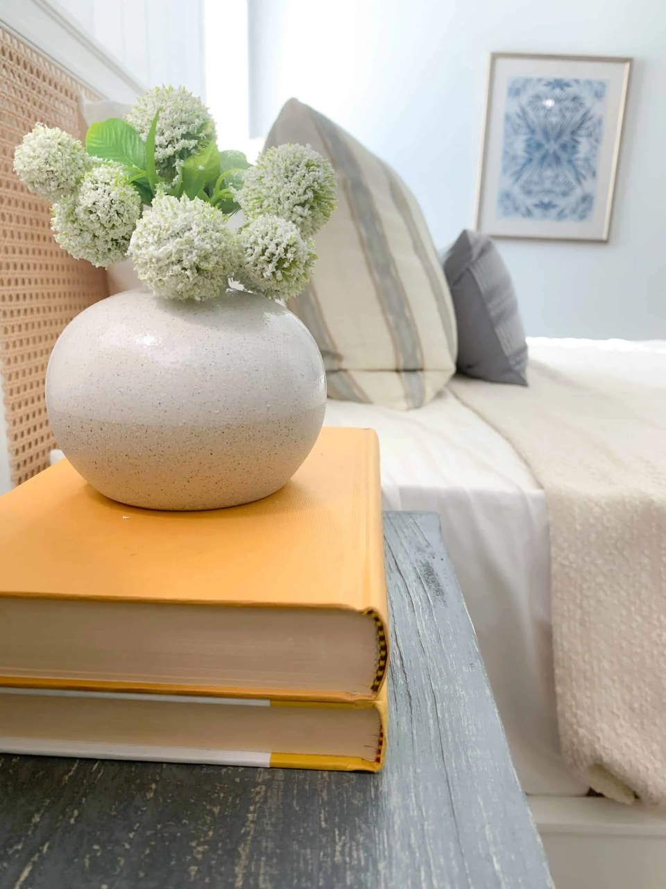 Bedside table styling - books and lamp