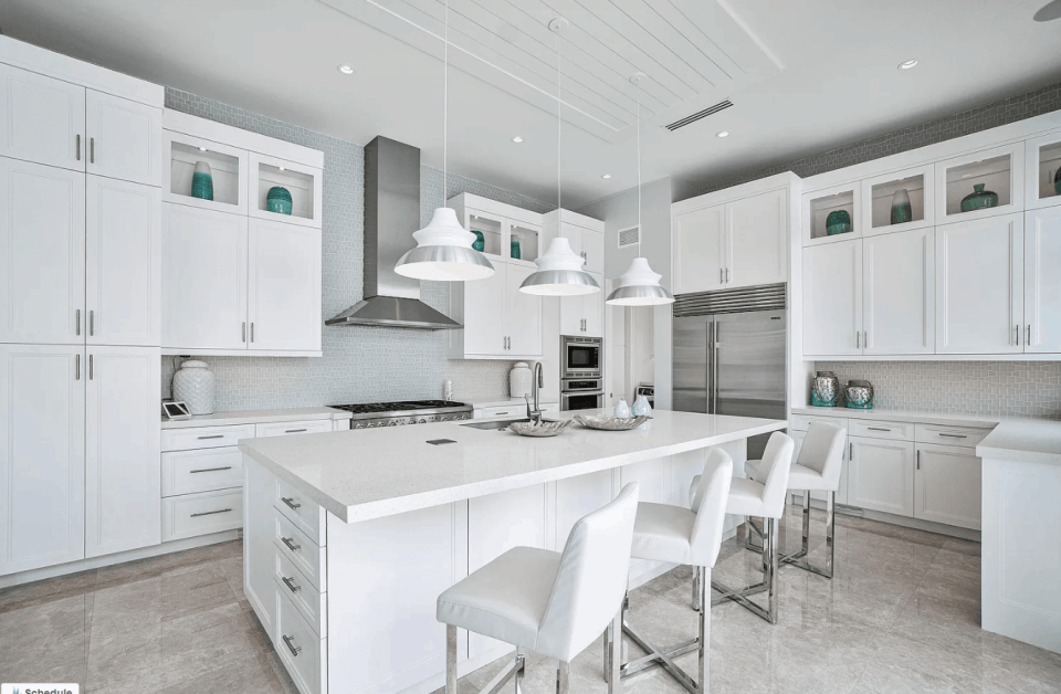 Open Kitchen, White Cabinets, White  Island, Muted Blue Backsplash, White Pendant Lights