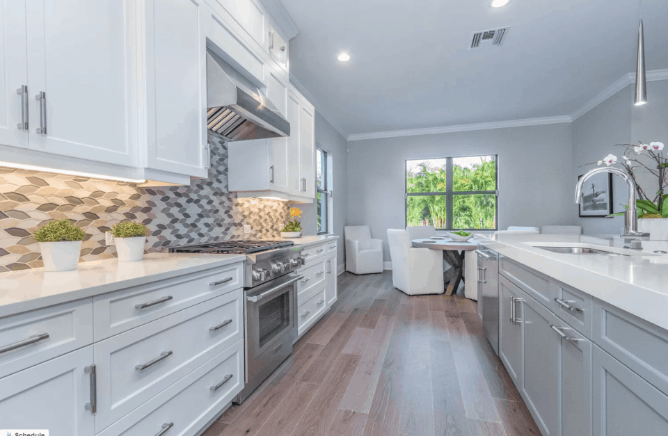 Model home white kitchen with fun backsplash