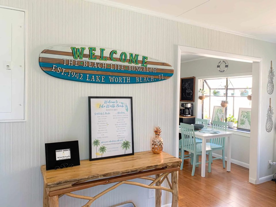 Customized Surfboard Sign With House Name - AirBnb Decor Tricks To Wow Your Guests