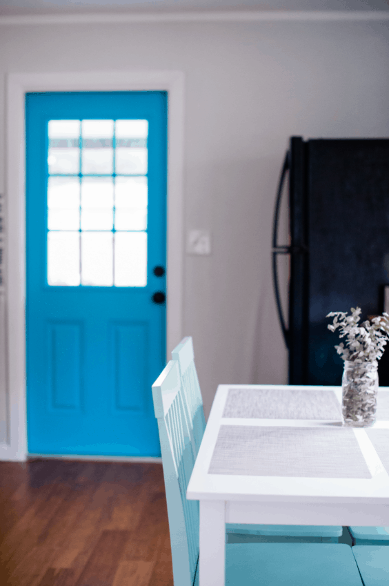 Bold Blue Kitchen Door in Beach Bungalow Vacation Rental - Paint an interior door for a fun and easy DIY home decor project