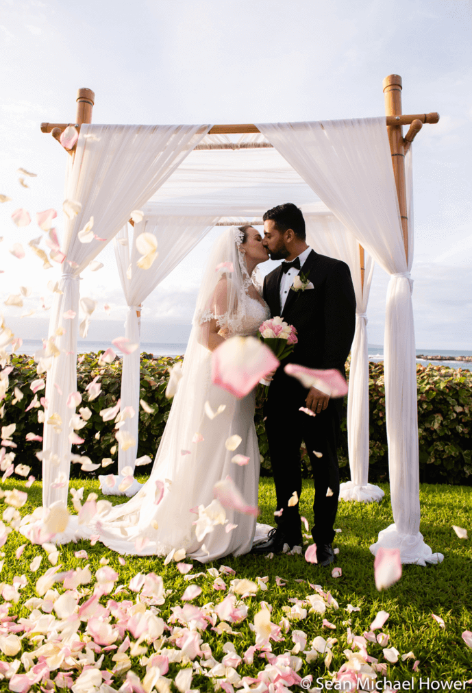 Wedding Bliss Flying rose pedals maui beach wedding under a chuppah