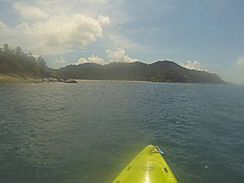 Yellow tip of kayak heading for a tropical beach