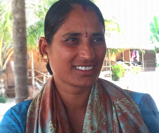 Indian hindu woman with golden earrings and a red dot on her forehead