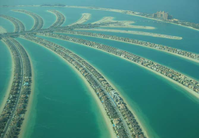 Aerial view of the man-made Dubai Palms, Palm Jumeirah and Palm Jebel Ali of Dubai, UAE.