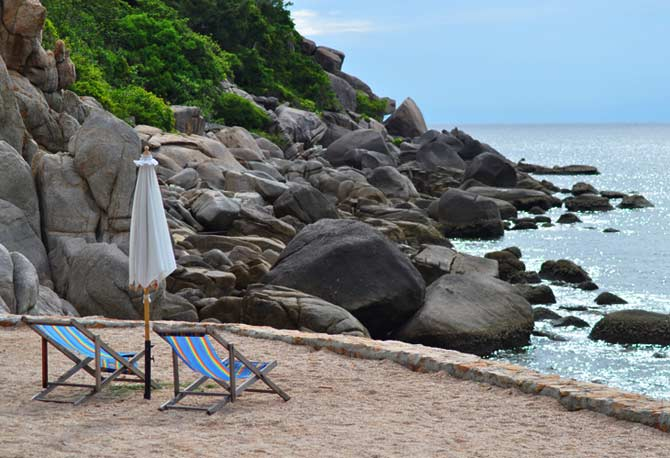 Artificial beach deck with beach chairs and sea view at Koh Tao, Thailand