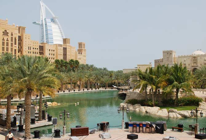 Artificial pond and island in Dubai with palms and Burj al Arab in the background