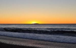 Amazing beach sunset at Haast Beach on the west-coast of New Zealand