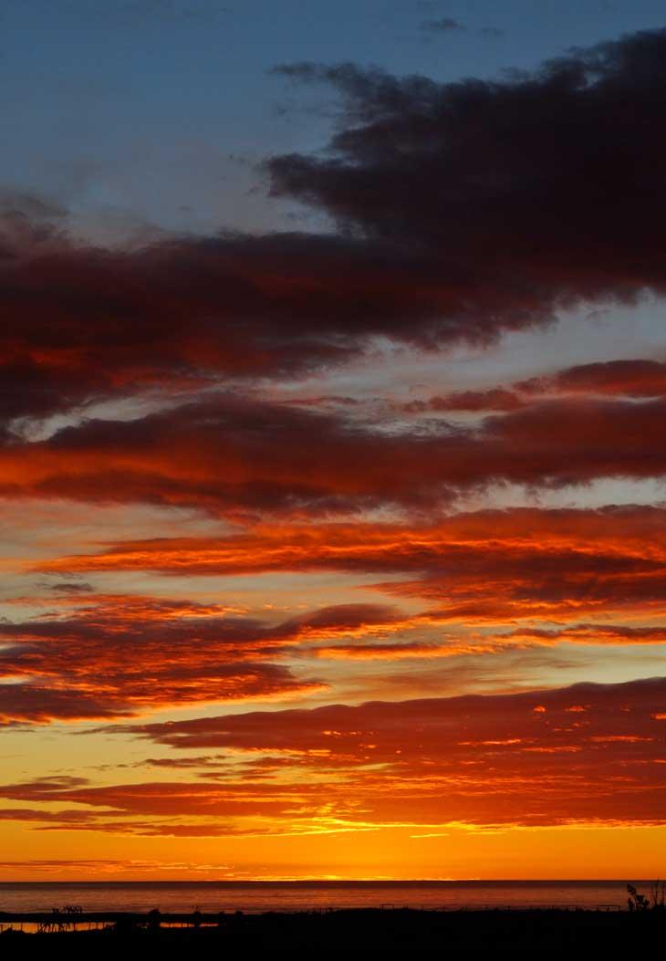 Beautiful beach sunset in the west-coast of New Zealand at Paparoa National Park