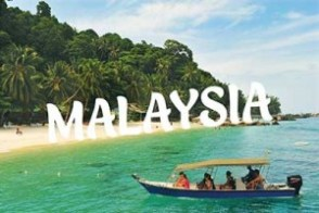 Malaysian tropical beach and boat with tourists