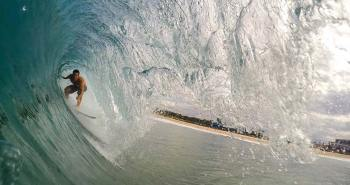 surfer taking a barrel wave in New Zealand
